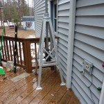 W1JWC uses a roof mount tripod bolted on his deck as a foundation for his push up mast.